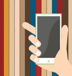 Smartphone on hand on plank wood background vector