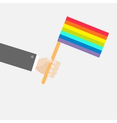 Businessman hand holding rainbow gay pride flag vector