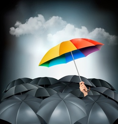 One rainbow umbrella standing out on a grey vector image