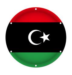 Round metallic flag of libya with screw holes vector