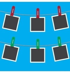 Blank photo frames on a clothesline vector