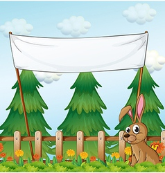A rabbit near the wooden fence below the empty vector image vector image