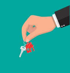 Hand and metal key with keychain house vector