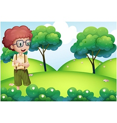 Boy standing at the top of the hill vector