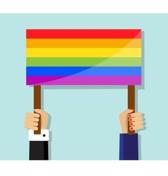 Hand holding a gay pride flag vector