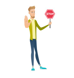 Young caucasian businessman holding stop road sign vector