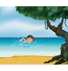 A boy swimming at the beach with an old tree vector