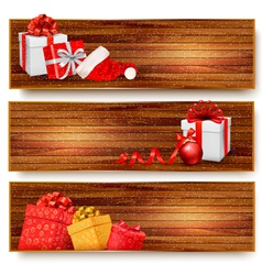 Three christmas banners with gift boxes and santa vector image