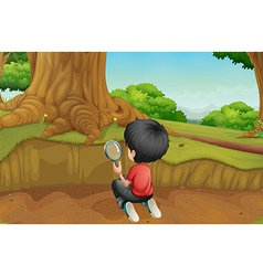 A boy studying the ground in the forest vector