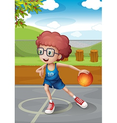 A young boy playing basketball wearing a blue vector image