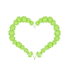 Four leaf clovers in a beautiful heart vector