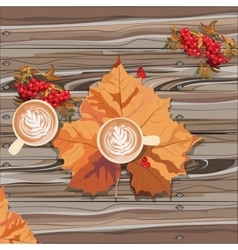 Hot steaming cup of coffee and autumn leaf vector