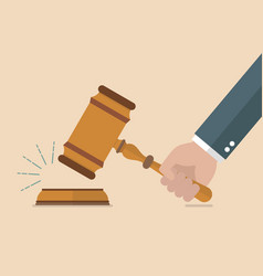 Hand holding judges gavel vector
