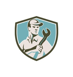 Mechanic holding spanner front shield retro vector