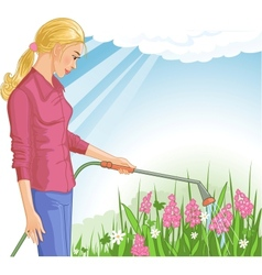 Young woman watering flowers in the garden vector image vector image