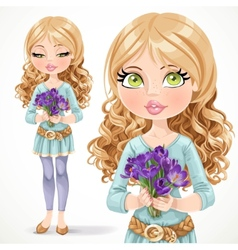 Beautiful blond girl holding a bouquet of crocuses vector