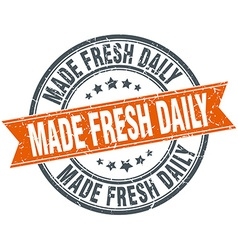 Made fresh daily round orange grungy vintage vector