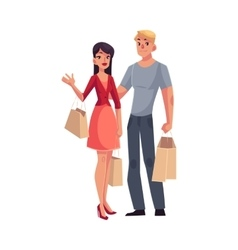 Couple of young man and woman with shopping bags vector