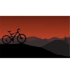 Bike silhouette in hills vector