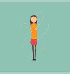 Girl freezing and shivering on a very windy day vector