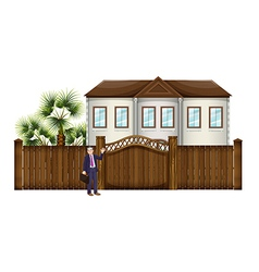 A man showing the big house vector image