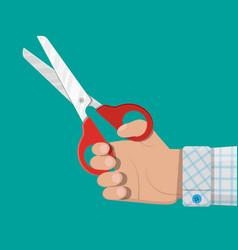 Hand holding scissors flat style vector