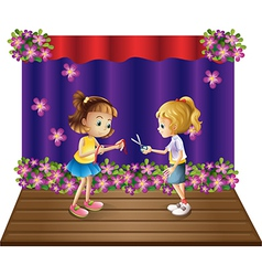 Two kids at the center of the stage vector image