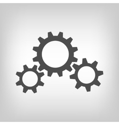 Three grey gear wheels vector