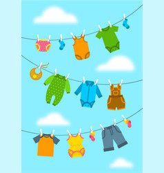 Baby clothes hanging on ropes with clothespins vector