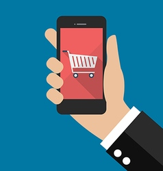 Hand holding smartphone with cart icon vector image vector image