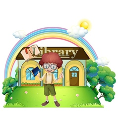 A boy in front of the library in the hilltop vector image