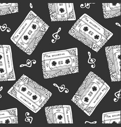Seamless pattern with vintage cassettes black and vector