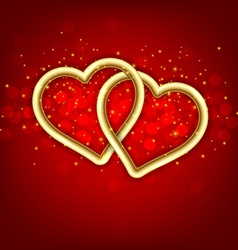 Two golden linked hearts vector
