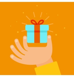 Hand giving present in flat style vector