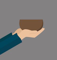 Hands of beggar with bowl vector