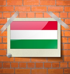 Flags hugary scotch taped to a red brick wall vector
