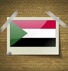 Flags sudanat frame on a brick background vector