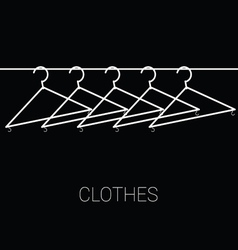 clothes hangers on black vector image