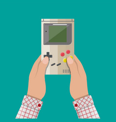 old gadget handheld game console in hands vector image