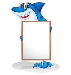 A smiling shark holding an empty whiteboard vector