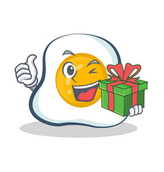 Fried egg character cartoon with gift vector