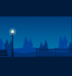 silhouette of fence on garden with street lamp vector image vector image