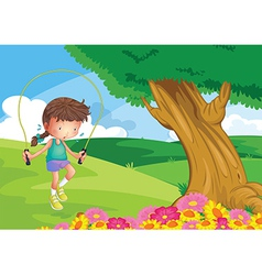 A girl playing jumping rope at the hill vector
