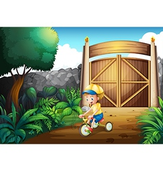 A small child playing inside the gate vector image