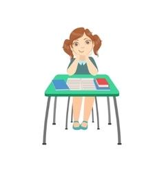 Schoolgirl sitting behind the desk in school class vector