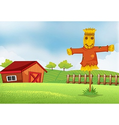 A farm with a barn and a scarecrow vector image vector image