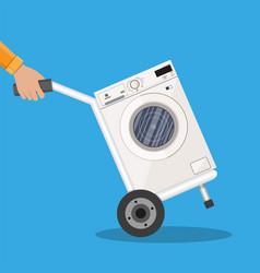 metallic hand truck with washing machine vector image