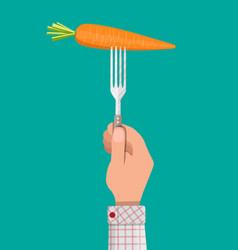carrot vegetable on fork in hand vector image