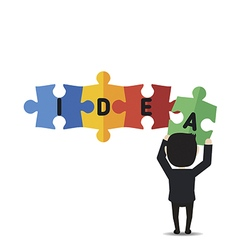 Businessman holding up jigsaw puzzle pieces vector