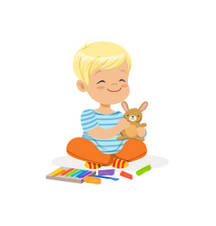 Ute little boy playing with plasticine kids vector